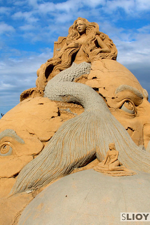 This sandcastle, a clear reference to the famous 'Little Mermaid' statue in Copenhagen, is evocative of both the cultural history of the city and the quirkiness that makes it special.