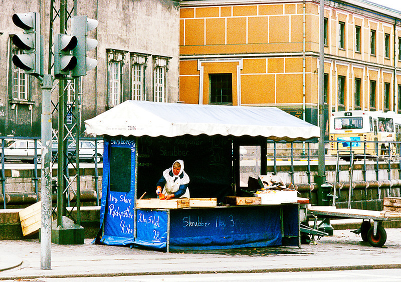 Setting up a fish market stand in Nyhavn which means 'new harbor'. Copenhagen was initially a through waterway between Zealand and the island of Amager that got too shallow for use, probably as a result of urban run off and siltation.