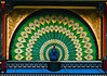 "The curtain of the Chinese style Pantomimeteatret (Pantomime Theater) is a peacock's tail which opens by folding down.<br /> <br /> Since 1874, the theatre has been the home of Italian pantomimes, introduced in Denmark by the Italian Giuseppe Casorti. Based on the Italian Commedia dell'Arte, the cast includes the characters Cassander (the old father), Columbine (his beautiful daughter), Harlequin (her lover) and the stupid servant Pierrot.<br /> <br /> For a peek at Pierrot at lunch, see <a href=""http://smu.gs/14sj7VN"">http://smu.gs/14sj7VN</a>"