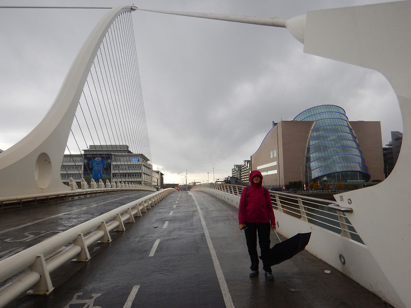 Robin, on the Samuel Beckett bridge, rainy first day in Dublin, before the Insight Tour started.