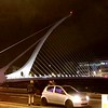 the Samuel Beckett Bridge at night.