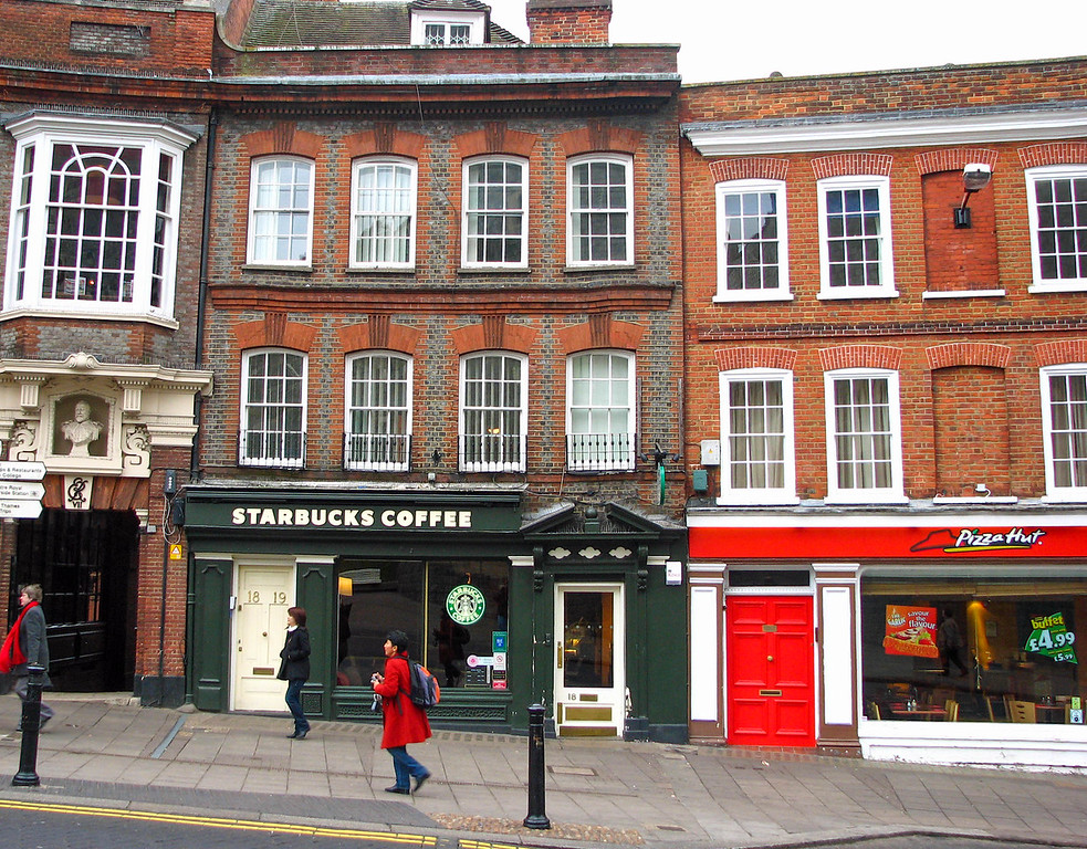 If the Queen ever wants a frappucino or pan pizza, there's a Starbucks and Pizza Hut directly across the street from Windsor Castle