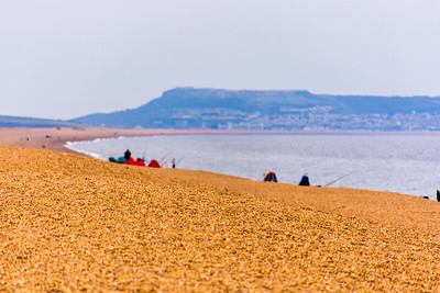 Fishermen along Jurassic Coast Beach