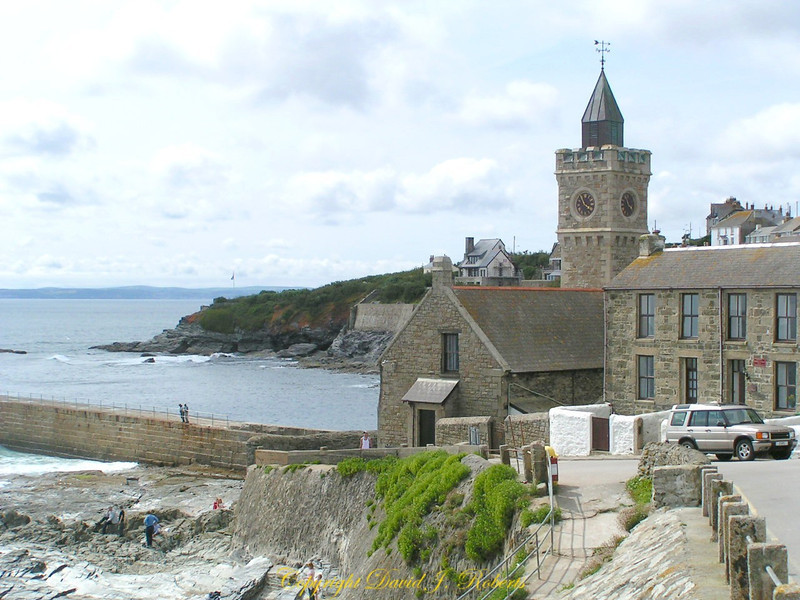 Church and clock tower at harbor entrance in Porthleven, Cornwall, England