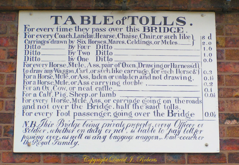 Tolls to cross the Iron Bridge over the River Severn, England