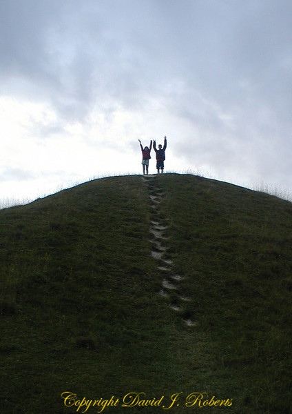 My kids on an ancient burial mound near Avebury, Wiltshire, England