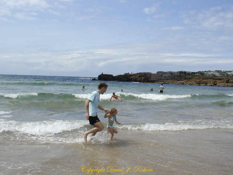 Playing in the surf on a beach in Cornwall England