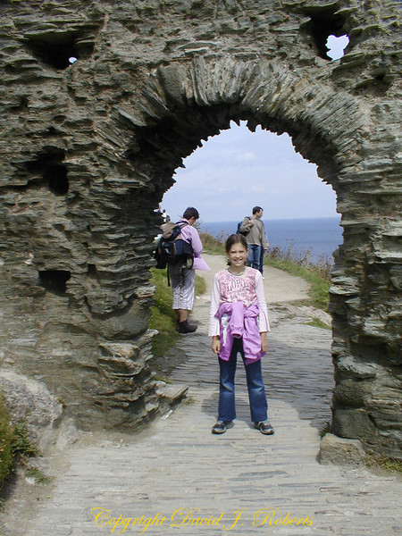 Rachel in an archway at Tintagel Castle