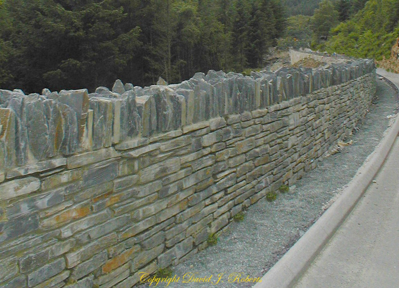 Roadside wall in Wales with slate plates on the top