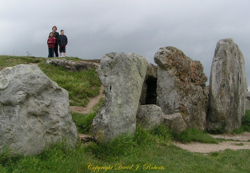 Burial mound near Avebury. My family contemplates thousands of years of history.