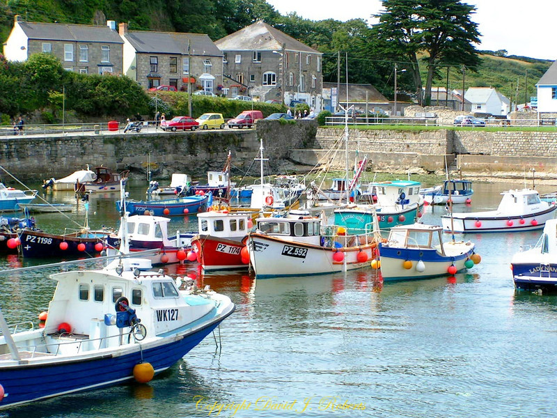 Protected harbor and small fishing boats in Porthleven, Cornwall, England