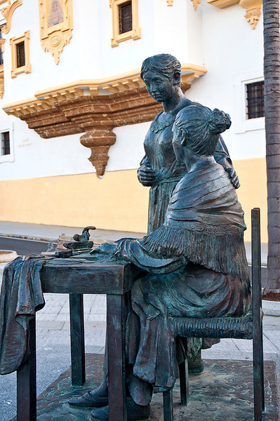 This bronze -- Monumento a las Cigarreras -- remembers the women who rolled the cigars here for centuries.