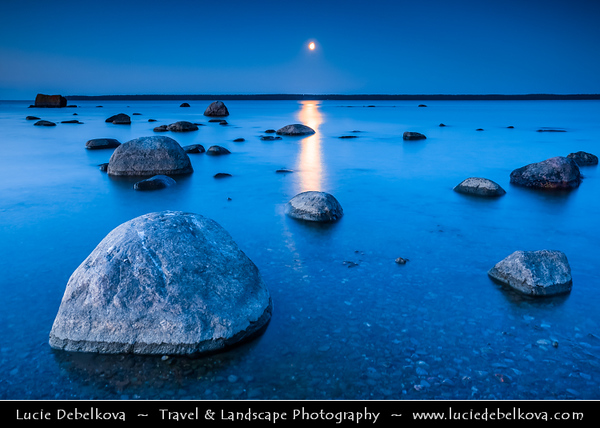 Europe - Estonia - Harju County - Lahemaa National Park - Boulders in Käsmu at Gulf of Finland - Baltic coast - Largest field of stones in Estonia, the big Uustalu Suurekivi - Summer Moon Rise during Dusk - Twilight - Blue Hour - Night
