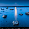 Europe - Estonia - Harju County - Lahemaa National Park - Boulders in Käsmu at Gulf of Finland - Baltic coast - Largest field of stones in Estonia, the big Uustalu Suurekivi - Summer Moon Rise during Dusk - Twilight - Blue Hour - Night