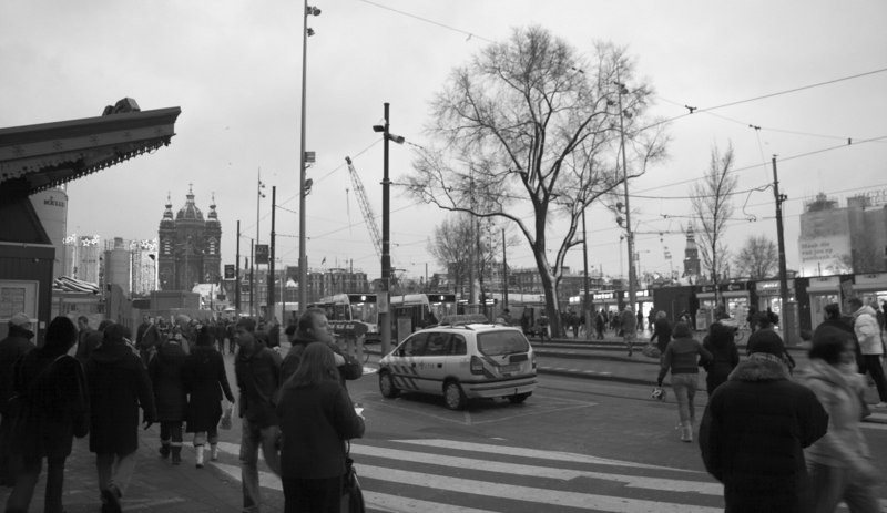 Outside the Amsterdam Centraal Train Station, I like the B&W version of this photo more.