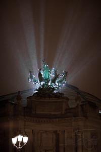 Weathering a downpour at the Grand Palais. Paris, France.