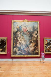 "rachel looking at ruben's epic ""the great last judgment"".  this gallery was actually designed to accomodate its dimension."