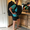 Robin tries out the front/back pack arrangement, at home before we leave.