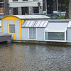 "Amsterdam Houseboat on Prinsengracht canal along with a ""Steelfish aluminium  tender"" boat"