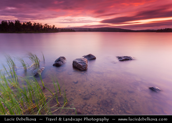 Finland - Lapland - Lappi - The largest & northernmost region of Finland - North of the Arctic Circle - Lake Inari - Inarijärvi - Inarinjärvi - Anárjávri - The third largest lake in Finland & the largest lake in Sápmi - Midnight Sun - Days that never end - When the sunset turns into sunrise - Dramatic & Stormy Midnigh Sky