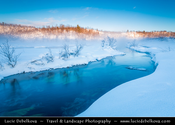 Europe - Finland - Lapland - Lappi - The largest & northernmost region of Finland - North of the Arctic Circle - Hot spring under fresh cover of snow during winter time
