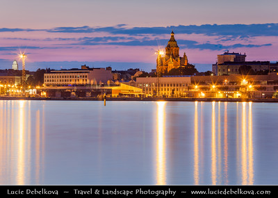 Finland - Helsinki - Helsingfors - Evening View of Russian Orthodox Church called Uspensky (Uspenski) Cathedral reflected in Baltic Sea - Dusk - Blue Hour - Twilight