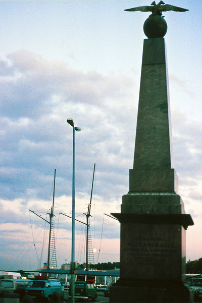 "South harbor at moonrise; I don't know what this a monument to, but the second word translates as ""salad.""<br /> <br /> Finland has been tossed around a lot in history wedged between the Swedish monarchs and Russian czars; neither Scandinavian nor Baltic (Finns are ethnically Norse.) with a language more closely related to Hungarian."
