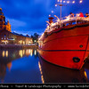 Finland - Helsinki - Helsingfors - Evening View of Russian Orthodox Church called Uspensky (Uspenski) Cathedral reflected in the sea & the Big Red Boat currently being used as a cafe - Dusk - Blue Hour - Twilight