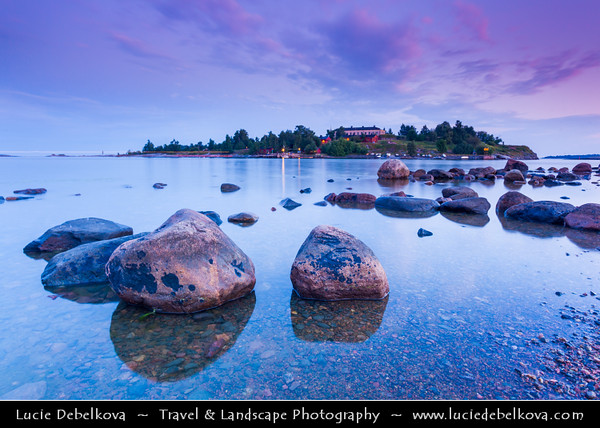 Finland - Helsinki - Helsingfors - Twilight at shores of Kaivopuisto park that borders the Gulf of Finland - Beach with lot of stones, rocks and boulders