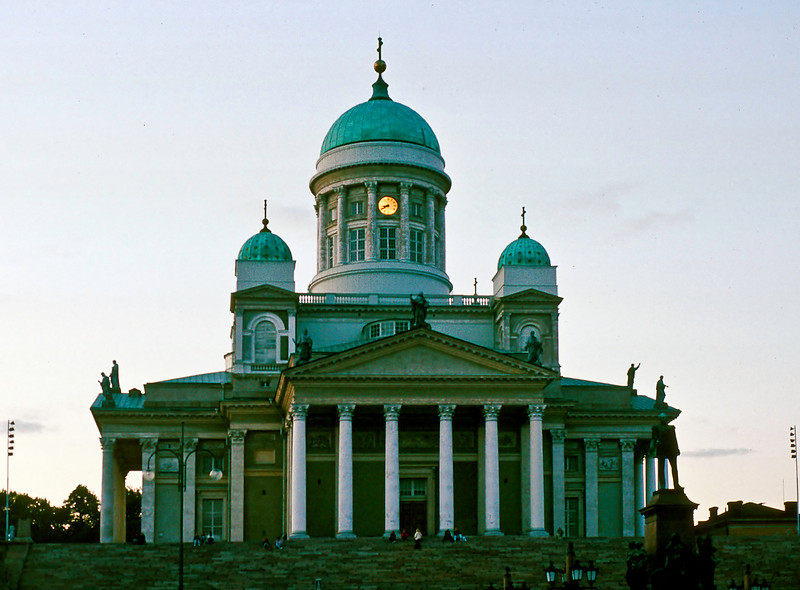 "The Helsinki Cathedral (originally the Cathedral of St Nicholas) is part of Carl Ludvig Engel's Senate Square, a unique architectural allegory of political, religious, scientific and commercial power.<br /> <br /> The guy in the right foreground is the (Russian) Emperor Alexander. The statue, erected in 1894, was built to commemorate his re-establishment the Diet of Finland in 1863, as well as his initiation of several reforms that increased Finland's autonomy from Russia for which he was known in Finland as ""the good czar.""<br /> <br /> Finland was ceded to Russia by Sweden in 1809 after 600 years."