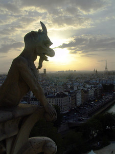 Gargoyle on top of the Notre Dame overlooking Paris & the Eiffel Tower