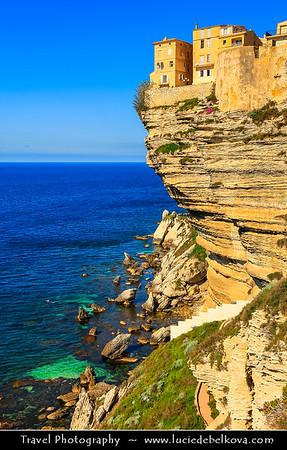 Europe - France - Corsica Island - Corse - Corse-du-Sud - Corsican South Coast on shores of Mediterranean Sea - Bonifacio - Bunifaziu - Historical Town with Medieval Citadel located on the promontory &  Harbor Port on Rocky Shores & famous white limestone cliffs