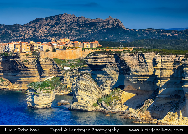Europe - France - Corsica Island - Corse - Corse-du-Sud - Corsican South Coast on shores of Mediterranean Sea - Bonifacio - Bunifaziu - Historical Town with Medieval Citadel located on the promontory &  Harbor Port on Rocky Shores & famous white limestone cliffs