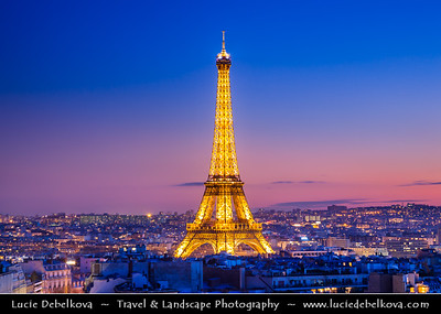 Europe - France - Paris - Capital City on Seine river - La Tour Eiffel - Eiffel Tower - La dame de fer - The iron lady - Famous Puddle iron lattice tower on Champ de Mars built in 1889 - Global icon of France & one of most recognizable structures in world - Twilight - Blue Hour - Dusk - Night