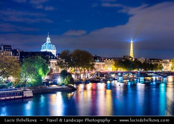 Europe - France - Paris - Capital City on Seine river - Cityscape along the river with La Tour Eiffel - Eiffel Tower - Famous Parisienne Landmark at Night