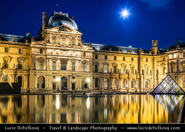 Europe - France - Paris - Capital City on Seine river - Musée du Louvre - Louvre Museum - Louvre Palace - Palais du Louvre - One of world's largest museums & most visited art museum in world - Central landmark of Paris - Pyramid - Twilight - Blue Hour - Dusk - Night