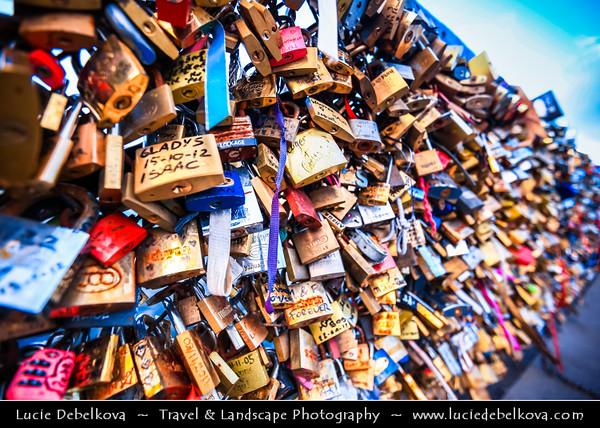 Europe - France - Paris - Capital City on Seine river - Pont de l'Archevêché - Love Locks Bridge crossing Seine river - Thousands of ribbons & padlocks attached to its railings create brightly-coloured mosaic