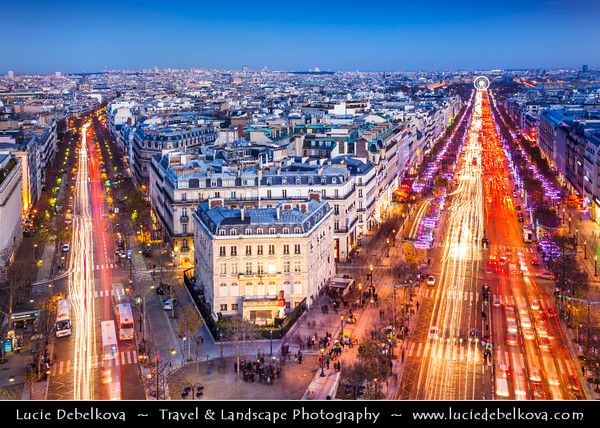 Europe - France - Paris - Capital City on Seine river - View from Arc de Triomphe - Arc de Triomphe de l'Étoile - One of the most famous monuments in Paris - Stands in centre of Place Charles de Gaulle at western end of Champs-Élysées - View towards the Champs-Élysées & Place de la Concorde with Giant ferris wheel