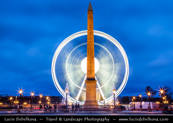 Europe - France - Paris - Capital City on Seine river - Place de la Concorde - One of major public Parisienne squares located between Champs-Elysées & Tuileries Garden - Iconic for giant cental Egyptian obelisk decorated with hieroglyphics & Giant ferris wheel at Dusk - Twilight - Night