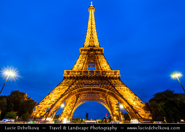 Europe - France - Paris - Capital City on Seine river - La Tour Eiffel - Eiffel Tower - La dame de fer - The iron lady - Famous Puddle iron lattice tower on Champ de Mars built in 1889 - Global icon of France & one of most recognizable structures in world - Twilight - Blue Hour - Dusk - Night