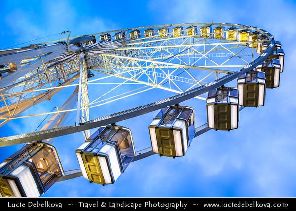 Europe - France - Paris - Capital City on Seine river - Place de la Concorde - One of major public Parisienne squares located between Champs-Elysées & Tuileries Garden - Giant ferris wheel at Dusk - Twilight - Night