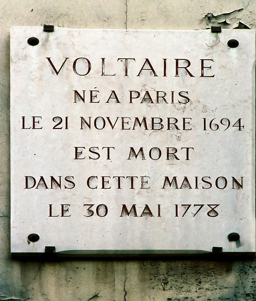 """François-Marie Arouet was a Jesuit-educated son of a minor treasury official who married into the nobility.<br /> <br /> He became a major force in the Enlightenment whose wit and satires led to his imprisonment (for something he had not written) after which he took the pen name Voltaire based on an extremely dense set of wordplays. (He is said to have used 178 other pen names.)<br /> <br /> Urged on his death bed by a priest to renounce Satan, he is reported to have said, """"Now, now, my good man, this is not the time to make enemies."""""""
