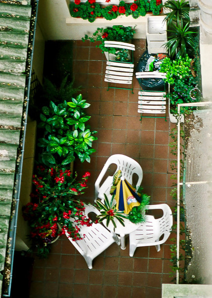 A tiny backyard patio somewhere in the 5ieme Arrondissement with its own tiny Cinzano umbrella.