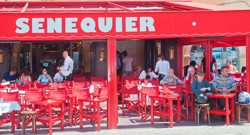 "The famous Senequier where according to legend Brigitte Bardot was discovered.<br /> <br /> If you look closely at the right background, you may see the beauty I discovered here.<br /> <br /> I knew I wanted to come to this place, but a friend who had been in St Tropez a few weeks before was raving about ""the red cafe"" which I assumed meant a place called Cafe Rouge.<br /> <br /> I had only seen black and white photos before."