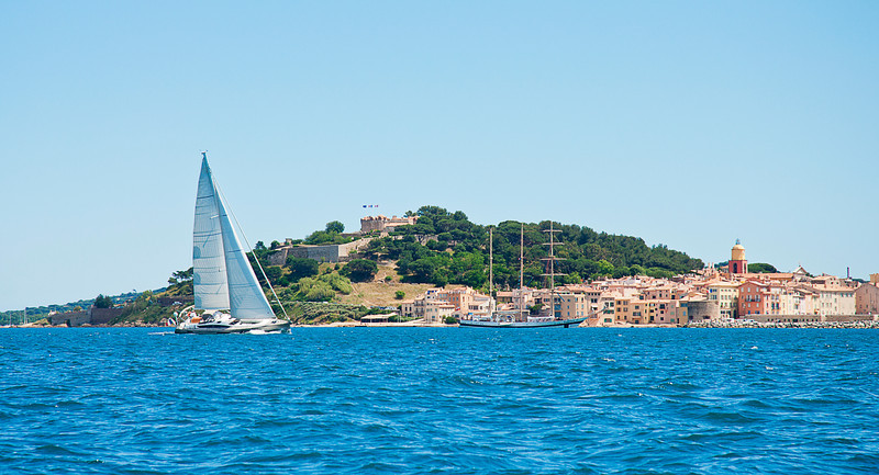 Modern yacht with standard Marconi rig; nice view of the old town on the right and the fortress and Citadel above center