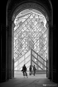 Silhouettes front the glass pyramid by I.M. Pei at the Musee de Louvre in Paris