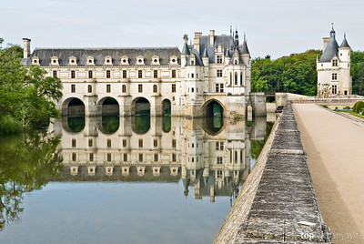 The Chateau de Chenonceau is reflected in the River Cher in the Loire Valley