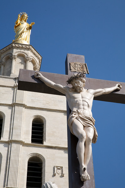 A statue of the virgin Mary on top of the 'Cathédrale Notre-Dame des Doms', and Jesus in front, Avignon.