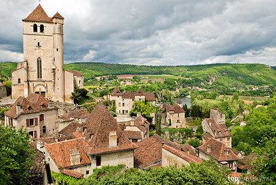 Dark clouds gather around the small French village of Saint-Cirq-Lapopie