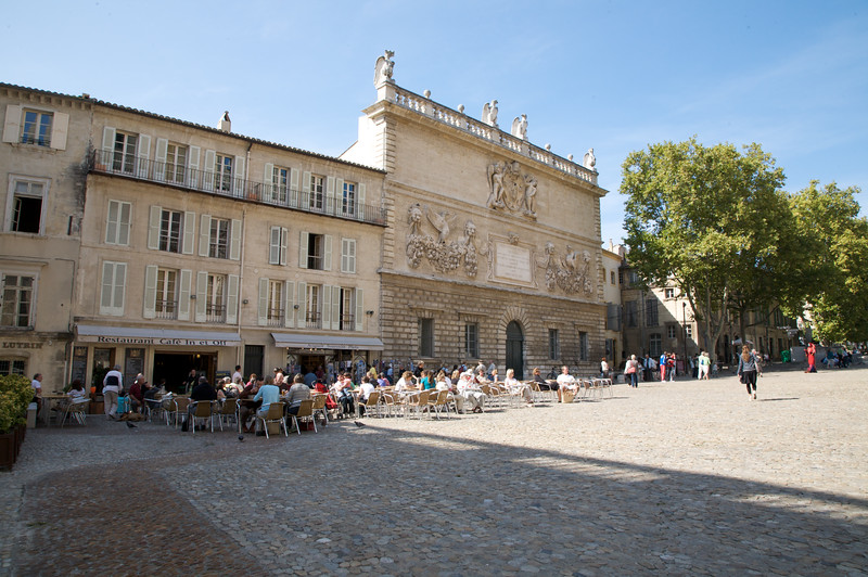 'Place du Palais' (Palace square) of 'Palais des Papes' (Palace of the Popes), Avignon. The building on the right is the 'Monnaies' mansion, built in 1619, and it is one of the best samples of the Baroque style of architecture in Avignon.